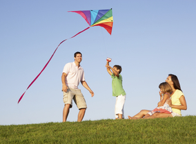 A family taking a kite out to play
