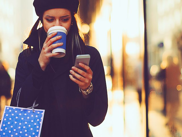 lady looking surprised passed a coffee cup at phone