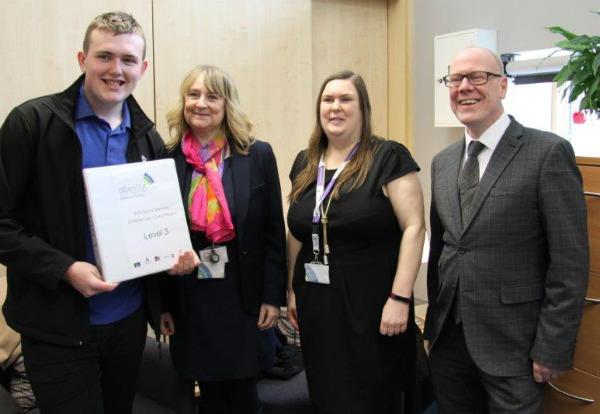 Declan undertaking his Modern Apprenticeship in Childcare with Aberlour meets Kevin Stewart MSP. With Susan Greig and Alison Mitchell of Aberlour.