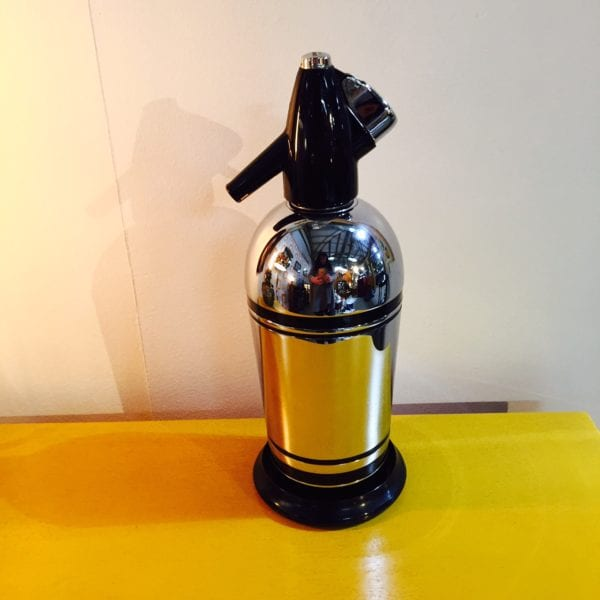 Chrome and black decorative Soda Syphon and holder from the 1960s