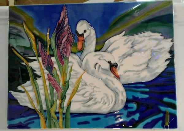 """Swimming Swans"" wall plaque"
