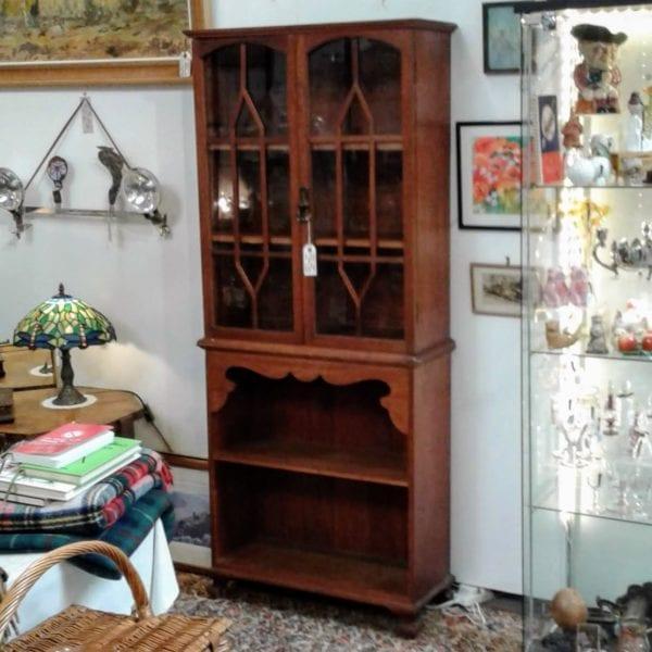 Neat oak glazed bookcase