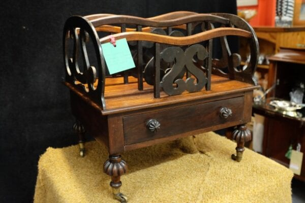 Canterbury, mahogany c19th, with drawer and castors
