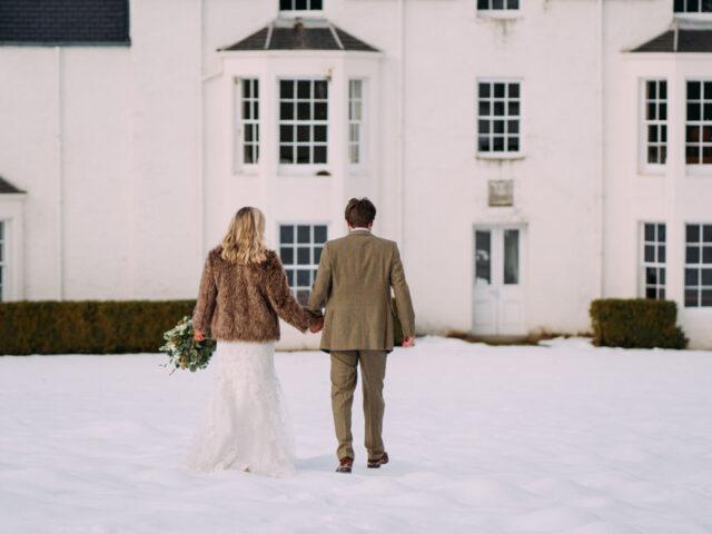 bride and groom walking towards Kindrochet lodge on Atholl Estate