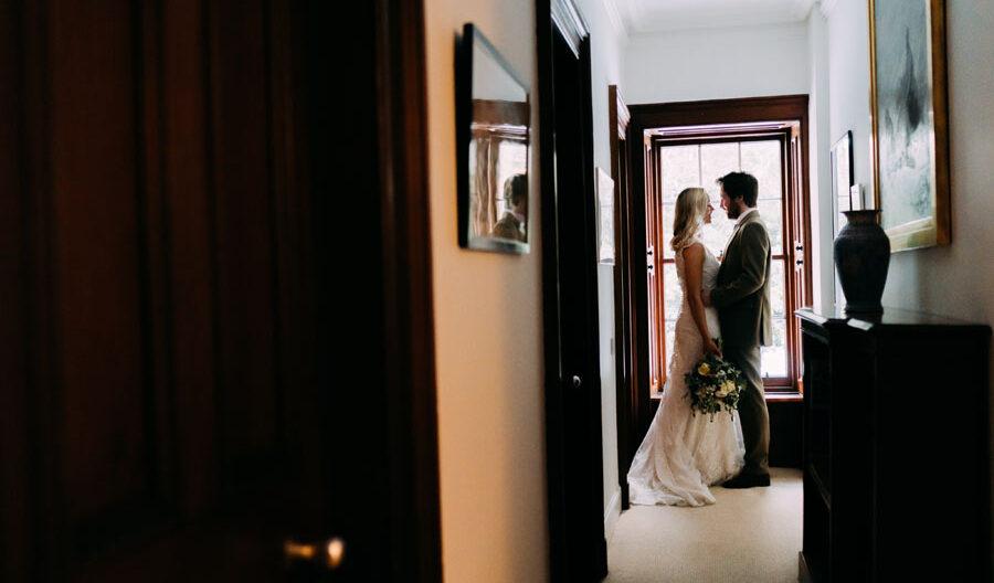 bride and groom in the hallway at Tulliemet Lodge