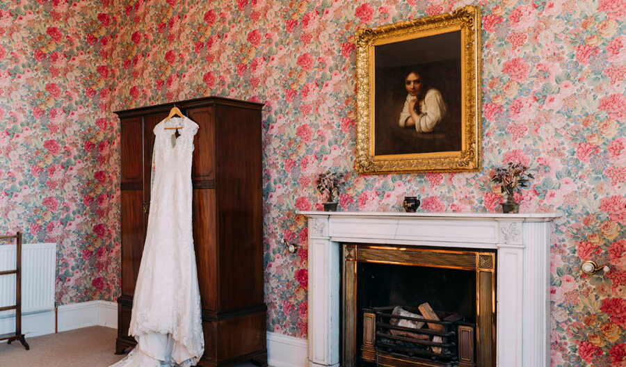wedding dress hanging in the bedroom at Tulliemet Lodge