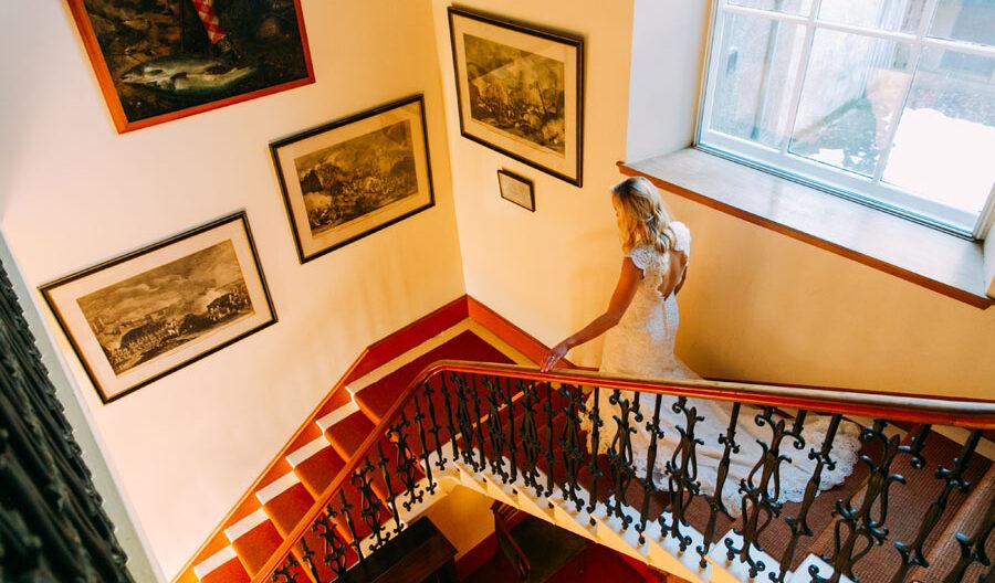 bride walking down the stairs in Tulliemet Lodge