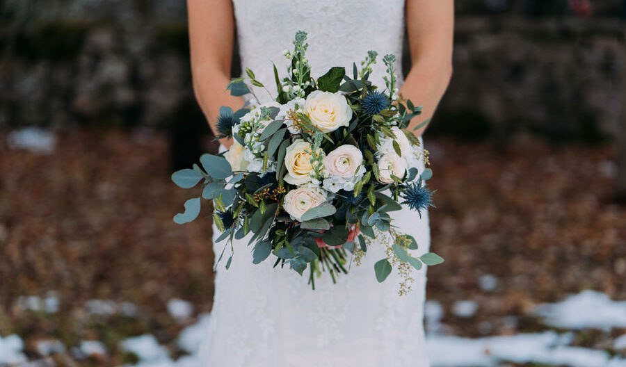bride standing with flowers