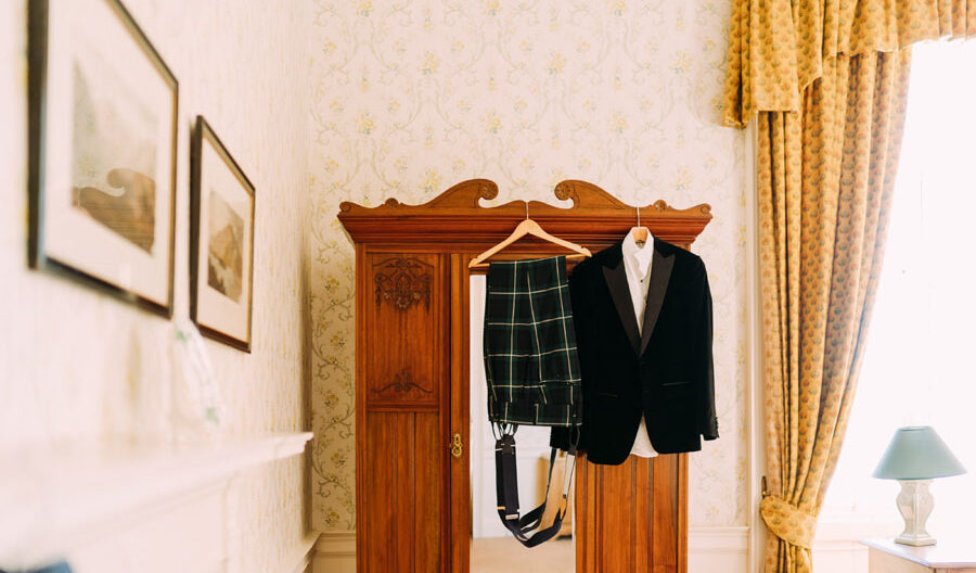wedding outfit hanging on mirror