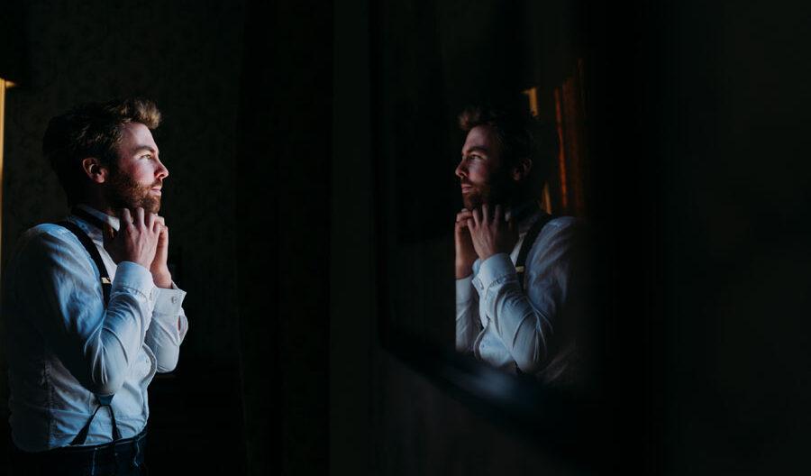 groom's reflection in mirror at Tulliemet lodge