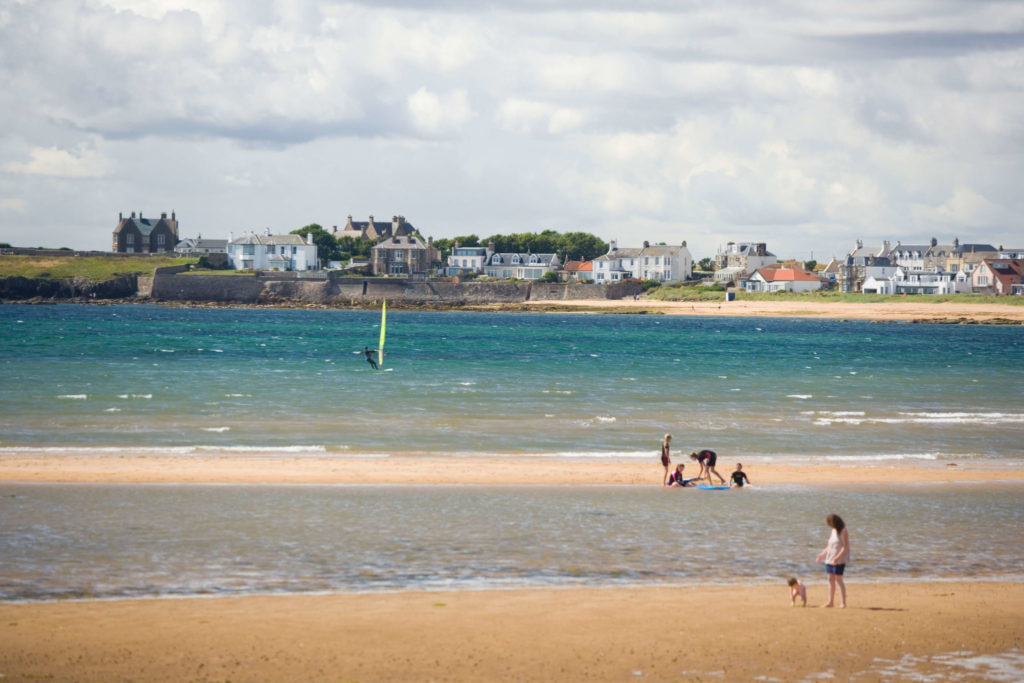 Modern image of people at the Elie beach harbour