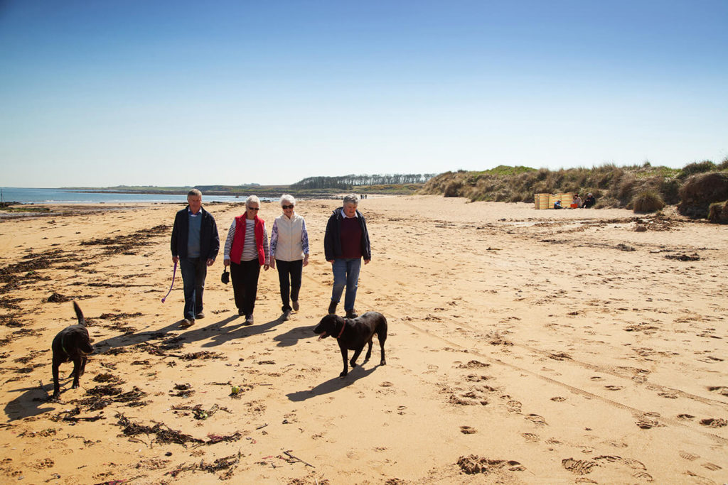 Kingsbarns Beach Fife family with dog walking along beach