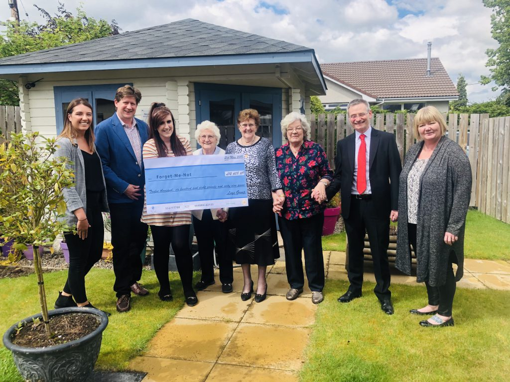 Leys Group presents donation to Forget Me Not Club