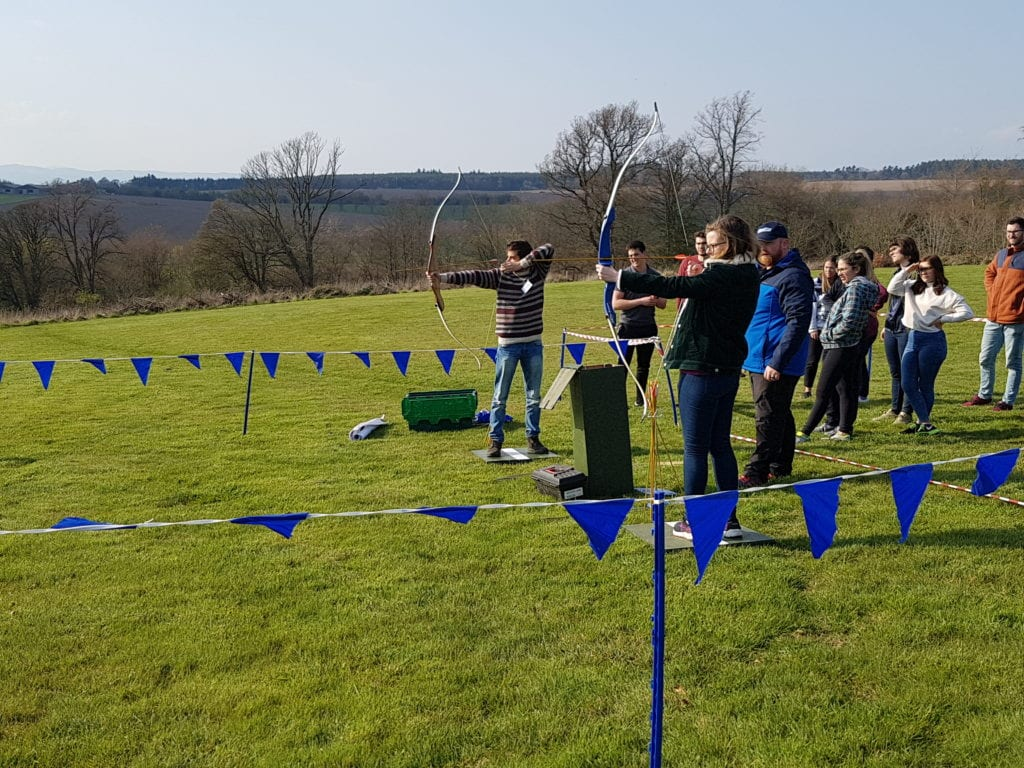 Students taking part in archery