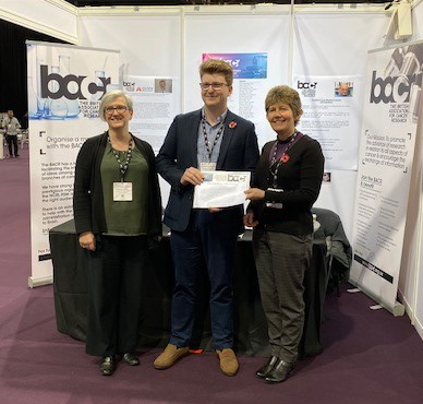 Hugh Nicholson with his award certificate wth the judges