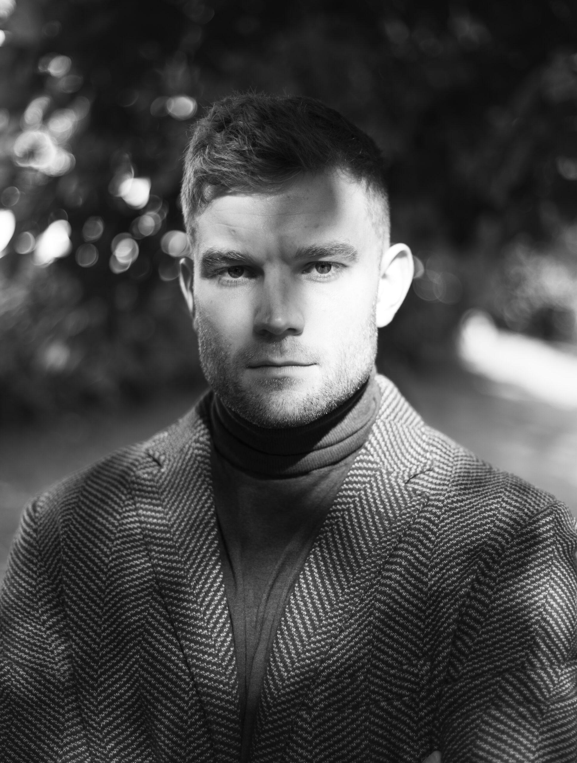 Male model wearing a jacket outside