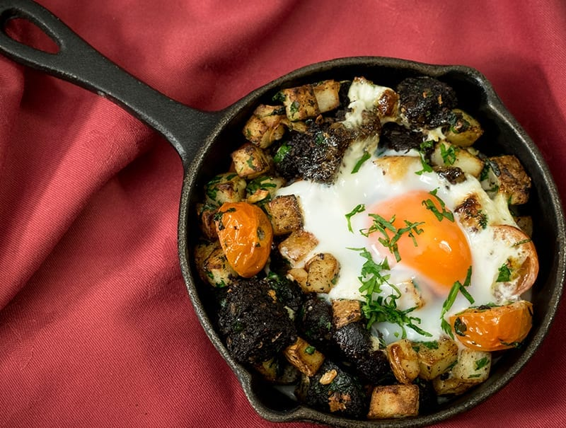 Black pudding, diced garlic potatoes, baked eggs brunch