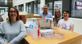 Suze, Darren, Lauren and Sandra with lab plasticware which is being sent to scientists in Malawi