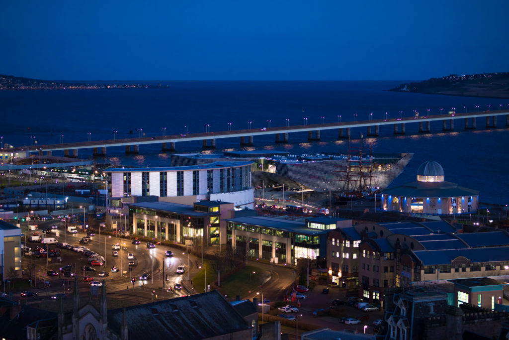Nighttime view of the Tay road bridge, V&A museum and Discovery Point