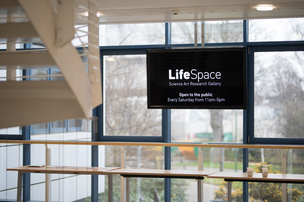 A TV screen announcing you are in the LifeSpace gallery at the School of Life Sciences