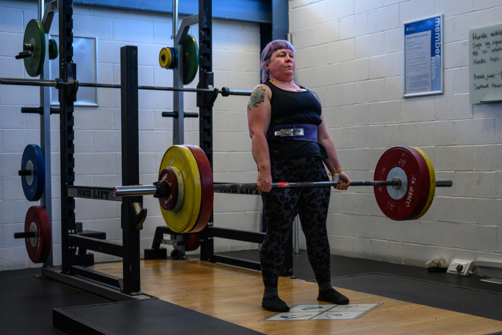 Irene Hallyburton stands strong as she deadlifts 100kg. Photo by John Post.