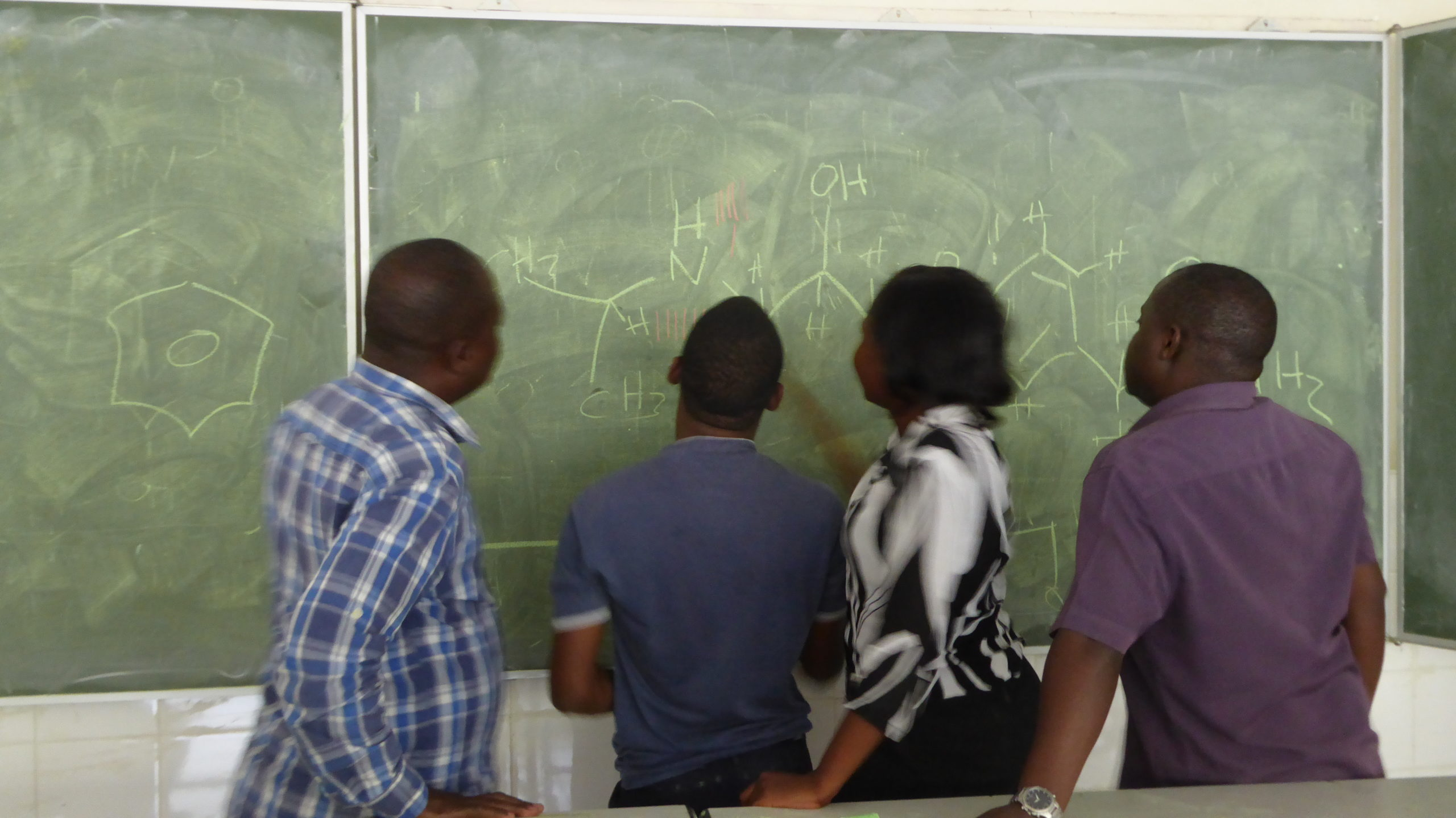 Chemistry class problem solving at the blackboard