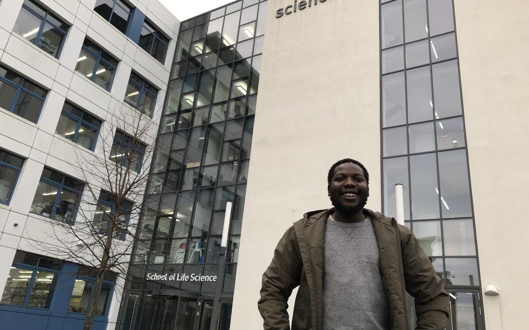 WCAIR Trainee Andrew Mtwea standing outside School Life Sciences building