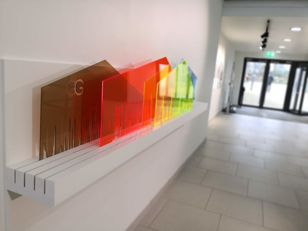 Large, colourful acrylic pieces representing DNA