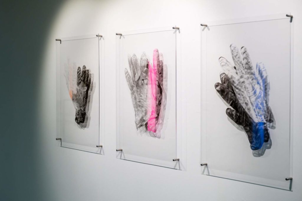 Three print images inspired by laboratory gloves