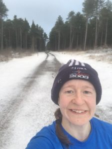 Susan Wyllie pauses on a run in snowy Tenstmuir forest
